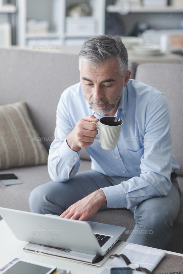 Businessman having a coffee break - Stock Photo - Images