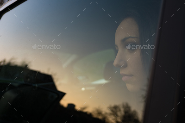 Girl sitting in a car - Stock Photo - Images