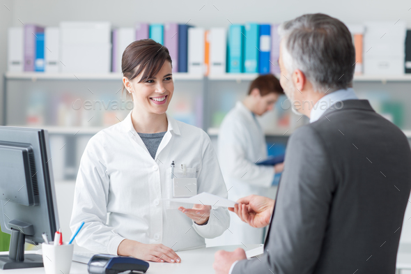 Man at the pharmacy - Stock Photo - Images