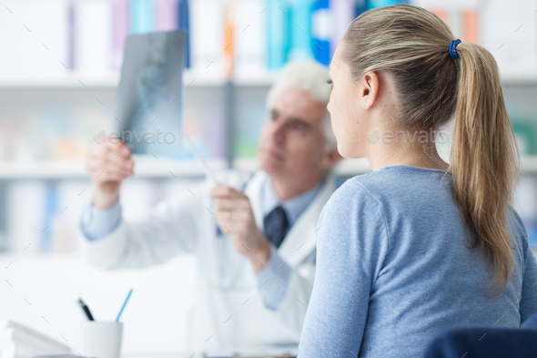 Doctor examining a patient's x-ray - Stock Photo - Images