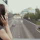 Sexy Business Woman Using Smartphone Standing On a Bridge Overlooking The Road, Steadicam Shot.  - VideoHive Item for Sale