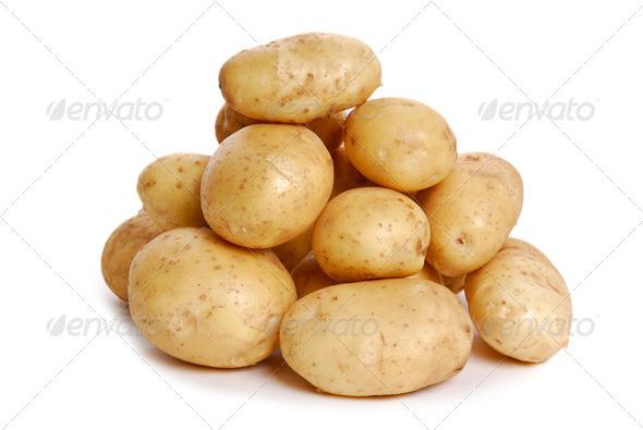 Heap of  Potato on white - Stock Photo - Images