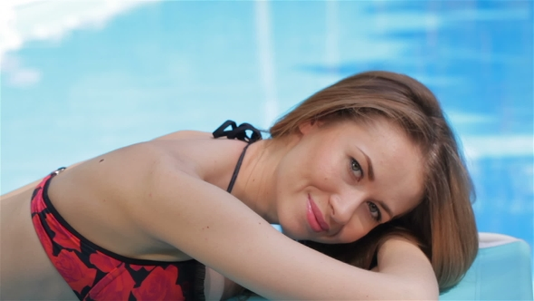 Female Model Poses Near The Swimming Pool By Kotlyarn
