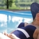 Woman Rests Near The Swimming Pool - VideoHive Item for Sale