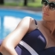 Woman Lies On Her Hip Near The Swimming Pool - VideoHive Item for Sale