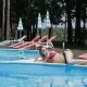 Woman Lies on the Side of the Swimming Pool - VideoHive Item for Sale