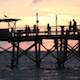Sunset Behind Pier with People Silhouetted  - VideoHive Item for Sale