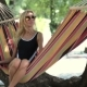 Young Lady Relaxing On Hammock On a Beach - VideoHive Item for Sale