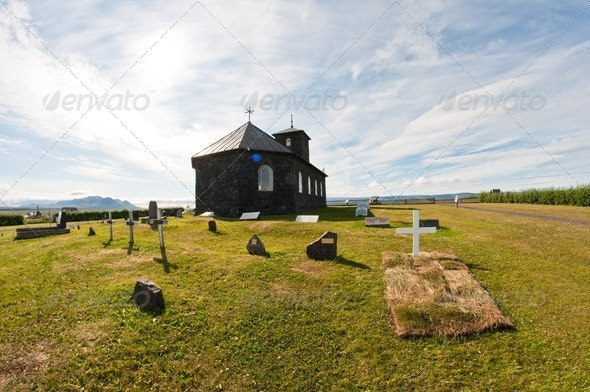 fresh grave by stone church in the country - Stock Photo - Images