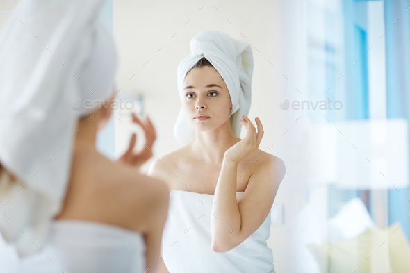 Looking in mirror - Stock Photo - Images