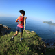 young fitness woman running on seaside mountain trail - PhotoDune Item for Sale