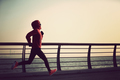 Young fitness woman runner running at winter seaside - PhotoDune Item for Sale
