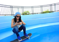 Woman listening player on skatepark - PhotoDune Item for Sale