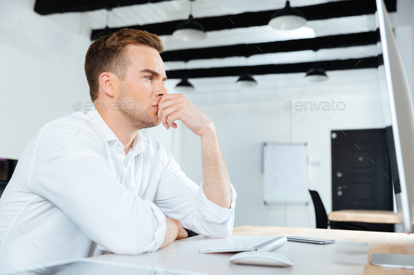 Businesman working with computer and thinking at workplace - Stock Photo - Images
