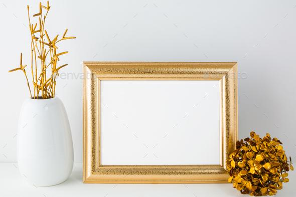 Landscape gold frame mockup with golden decor - Stock Photo - Images
