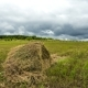 Haystack In The Field Of Clouds In The Sky, Farmers Cleaning Hay Harvest - VideoHive Item for Sale