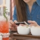 Brunette Girl Uses Smart Phone While Sitting Outside In a Cafe Hot Summer Day - VideoHive Item for Sale