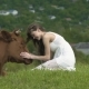 Happy Girl Strokes A Cow At Summer Day - VideoHive Item for Sale
