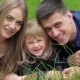 Portrait Of Young Parents And Little Girl Resting On Grass. Slowly - VideoHive Item for Sale