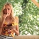 Sexy Smiling Woman Eating Vegetable At The Beach - VideoHive Item for Sale