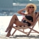 Attractive Woman Relaxing On Sun Lounger On Beach - VideoHive Item for Sale