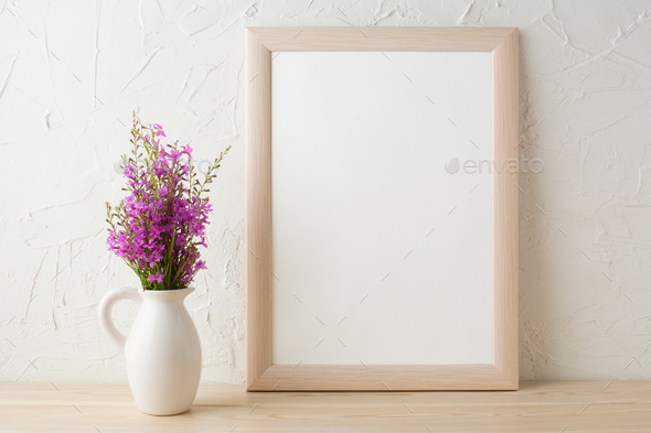 cdf03ab7598f Frame mockup with purple wild flowers bouquet Stock Photo by TasiPas
