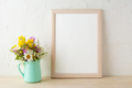Frame mockup with flowers in mint green vase - PhotoDune Item for Sale