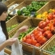 Young Pretty Girl Is Choosing Peppers In a Grocery Supermarket. Attractive Woman Selecting Fresh - VideoHive Item for Sale