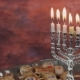Menorah With Candles Over Donuts On Wood Deck For Hanukkah Celebration. - VideoHive Item for Sale