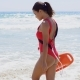 Female Lifeguard Steps Into Water On Summer Day - VideoHive Item for Sale