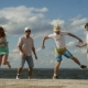 Group Of Four Friends Having Fun On The Beach - VideoHive Item for Sale