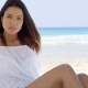 Gorgeous Young Woman Relaxing On The Beach - VideoHive Item for Sale