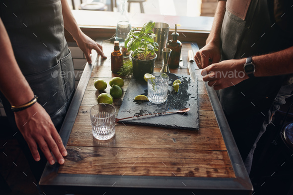 Barmen preparing new cocktail recipe - Stock Photo - Images
