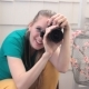 Smiling Female Photographer Taking Shots - VideoHive Item for Sale