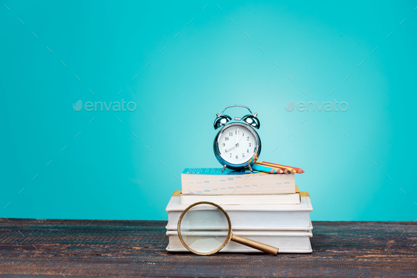 Back to School concept. Books, colored pencils and clock - Stock Photo - Images