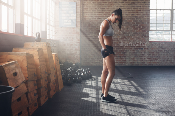 Determined young woman standing in gym - Stock Photo - Images