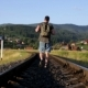 Man Walking On Railroad In Mountains - VideoHive Item for Sale