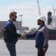 Two Dockers, Coworkers And Colleages Meet And Shake Hands In Shipping Cargo Port - VideoHive Item for Sale