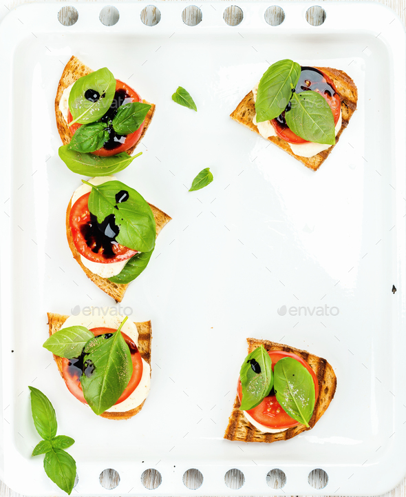 Caprese sandwiches with tomato, mozzarella cheese, basil and balsamic glaze - Stock Photo - Images