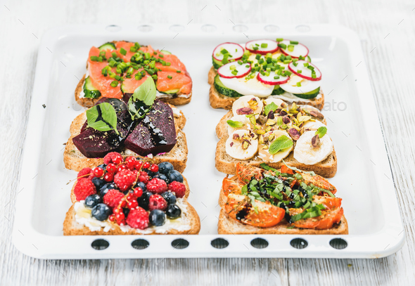 Sweet and savory breakfast toasts variety - Stock Photo - Images