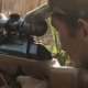 Man Takes Aim At The Sight Of The Rifle - VideoHive Item for Sale