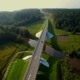 Aerial View Of Cars Going Over The Bridge In The Forest - VideoHive Item for Sale