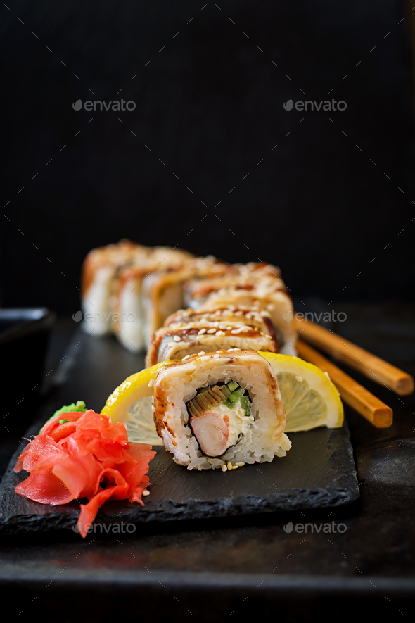 Traditional Japanese food - sushi, rolls and sauce on a black background. - Stock Photo - Images