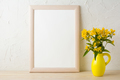 Frame mockup with yellow flowers in stylized pitcher vase - PhotoDune Item for Sale
