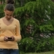 Girl Typing On Mobile Phone On The Street. - VideoHive Item for Sale