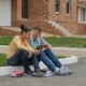 Couple Teenagers Sitting And Playing a Tablet. - VideoHive Item for Sale
