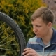 The Young Man Turns The Wheel Of The Bicycle. - VideoHive Item for Sale