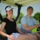 Young Couple Smiling in Cart at the Course - VideoHive Item for Sale