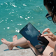 Beautiful Young Woman Hands Using Tablet PC On The Beach - VideoHive Item for Sale