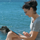 Beautiful Young Woman Using Tablet PC On The Beach - VideoHive Item for Sale